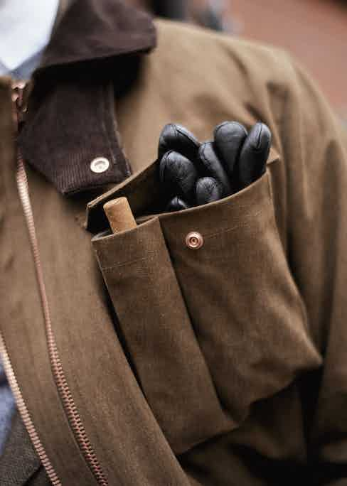The breast pocket has been divided into two, allowing you a safe storage compartment for your gloves, sunglasses, cigar and other miscellaneous items.