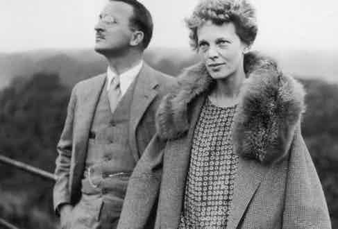 American aviatrix Amelia Earhart (1897 - 1937) on the roof of the Hyde Park Hotel in London, with Captain Hilton H Railey, 20th June 1928. At Railey's suggestion, Earhart had just completed a successful transatlantic flight. (Photo by Hulton Archive/Getty Images)