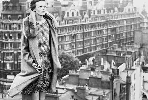 Original Caption) The above photo shows Miss Amelia Earhart, copilot of the transatlantic plane, Friendship, atop the roof of the Hyde Park Hotel in London, getting a view.