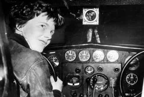 August 1937, American aviator and pilot Amelia Earhart is pictured at the controls of her aeroplane  (Photo by Popperfoto/Getty Images)