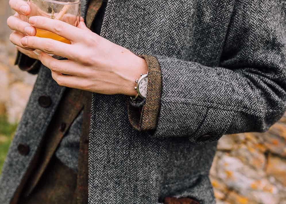 Ben St George wears a herringbone coat by Lucan, a tweed suit by Walker Slater and knitwear by Anderson & Sheppard.