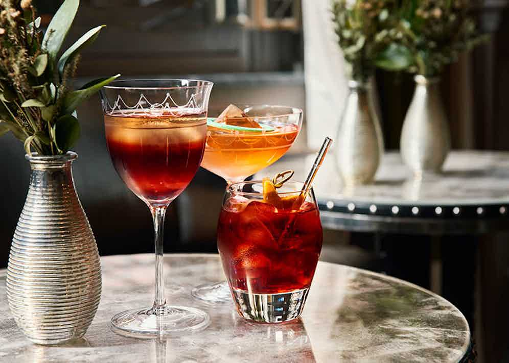 The Connaught Bar's three variations of the Negroni: 'Negroni 10 to 100'; 'Sweet and Z' and the classic Negroni.