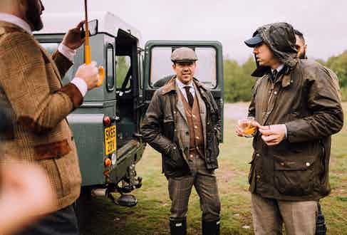 Mr Hranek looks every bit the Scottish estate sportsman in his gun club check suit and wax jacket.