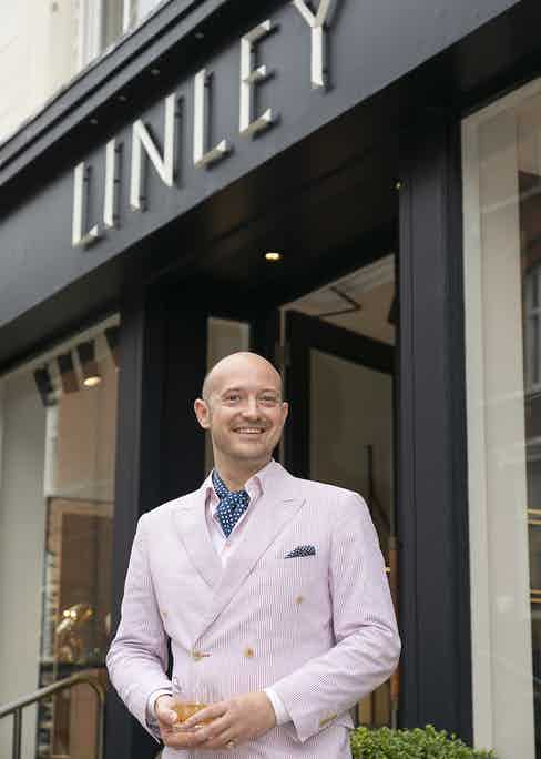 Max Warner on the steps of Linley's showroom on Chelsea's Pimlico Road.