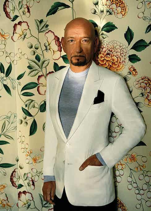 White linen jacket, Dolce & Gabbana; light blue cashmere, silk and linen sweater, Ermenegildo Zegna; denim jeans, Paige; navy silk pocket-square, Ermenegildo Zegna.