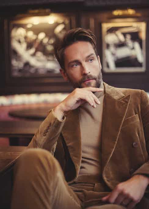 Beige velvet cotton double-breasted blazer suit and camel cashmere sweater, Ralph Lauren Purple Label.