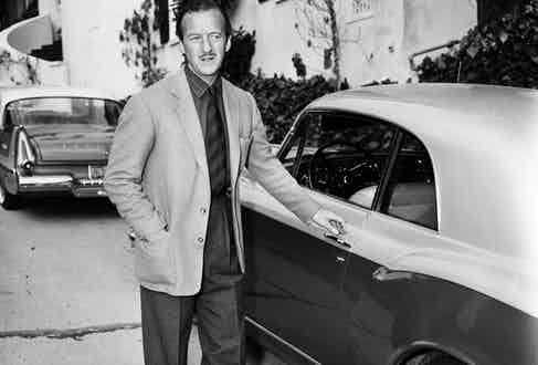 David Niven at the home of Elizabeth Taylor after Michael Todd's death. (Photo by USC Libraries/Corbis via Getty Images)