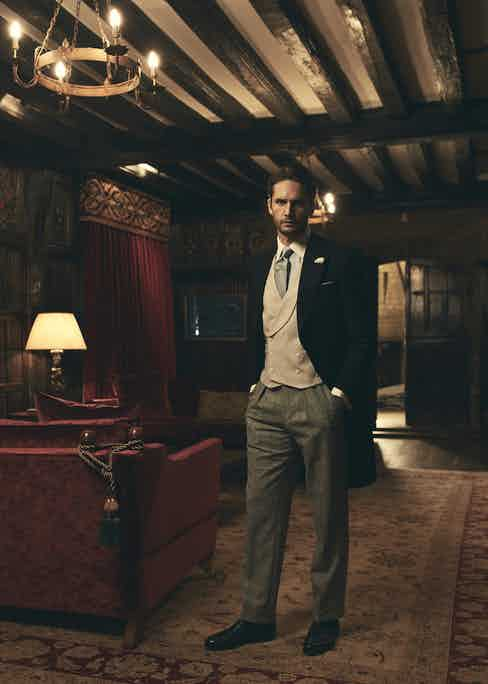 Black wool morning coat, Gieves & Hawkes; Nimbus grey wool V003 waistcoat with shawl collar vest, Kit Blake at The Rake; light-blue cotton contrast collar double cuff shirt, Turnbull & Asser at The Rake; navy and fawn checkerboard hopsack tie, Budd Shirtmakers; grey wool Blake check trousers, Kit Blake at The Rake; Lapworth silver-plated cufflinks, Alice Made This at The Rake; black leather loafers, Grenson. Tie pin, flower lapel pin and pocket square, stylist's own.