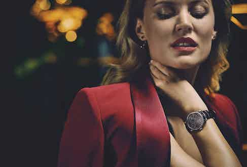 Red oversized satin-trimmed crepe blazer, Alice & Olivia; 18k white-gold Lange 1, A. Lange & Söhne; Diorama Précieuse earrings in yellow-gold, amethyst and Tsavorite garnets, Dior Joaillerie.