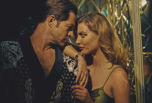 Him: Black and white silk dressing gown, Dolce & Gabbana. Her: Green Silk slip dress with purple lace detail, Agent Provocateur, Black Bay S&G 41mm steel case, steel and yellow-gold bracelet, Tudor.