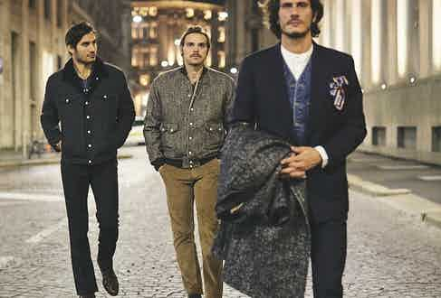 Left to right: Japanese cotton-linen pinstriped Bud shearling trucker jacket; indigo blue Giuliano Oxford shirt; Stendhal snakeskin printed leather boots; trousers, his own. Muddy VBC x Barbanera wool shearling bomber light brown corduroy Bronson trousers. Blue washed denim Jesse vest; white Giuliano jacquard cotton Oxford shirt: dark brown kudu waxy leather Guttuso loafers. Suit, his own.