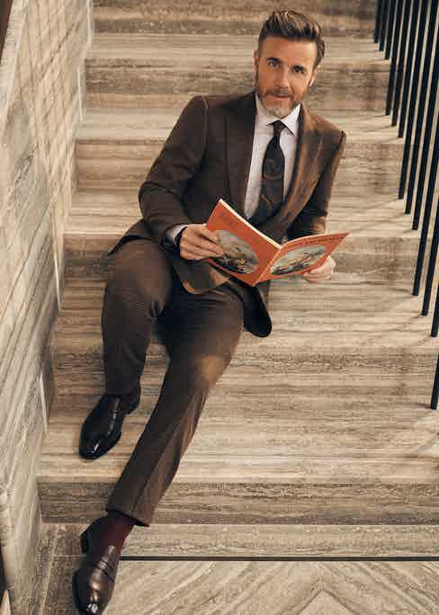 Brown wool check suit, Cifonelli; white cotton striped shirt, Corneliani; brown, mustard and navy silk tie, Drake's; burgundy cotton sock, London Sock Company; brown leather loafers, Gaziano & Girling.