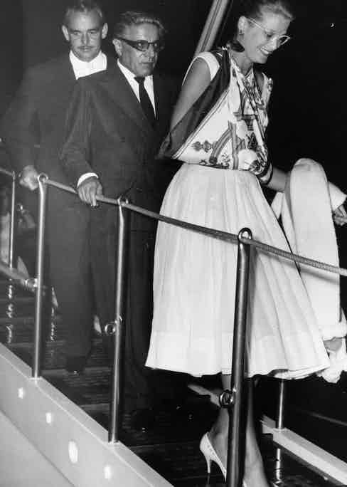 Rainier and Princess Grace leave Onassis's yacht. (Photo by Getty).