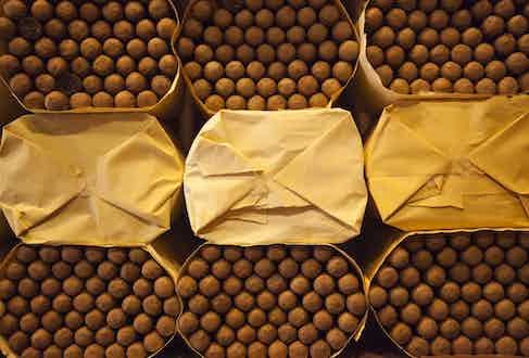 Stacks of cigars at the factory. (Photo courtesy of Getty Images)
