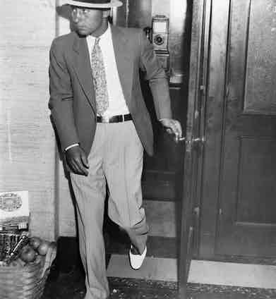 UNITED STATES - CIRCA 1920:  Longtime Capone enforcer and bodyguard 'Machine Gun' Jack McGurn is seen leaving a phone booth at an unidentified location in Chicago, ca.1920s. (Photo by Chicago History Museum/Getty Images)