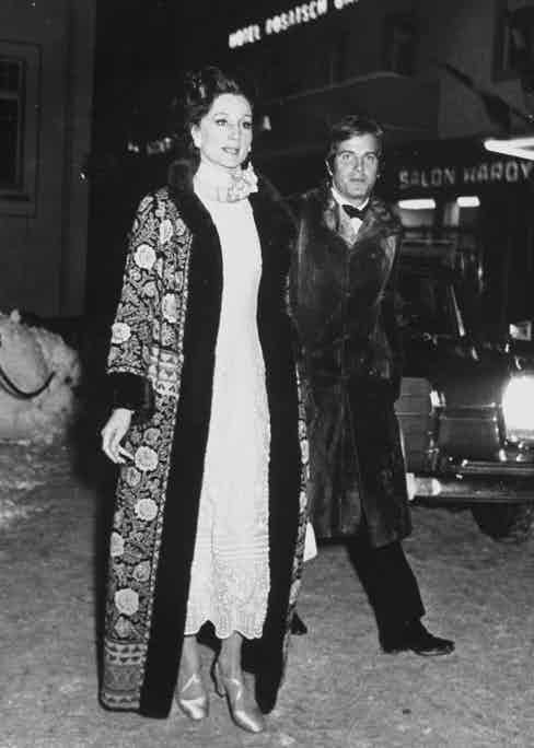 Viscountess Jacqueline de Ribes wearing floor-length, fur-lined over formal dress, walking with escort Massimo Gargia. (Photo by Roland Schoor/Pix Inc./The LIFE Images Collection/Getty Images)