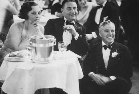 Charlie Chaplin (R) with brother Sydney and unidentified woman enjoying themselves in St. Moritz. (Photo by Alfred Eisenstaedt/Pix Inc./The LIFE Picture Collection/Getty Images)