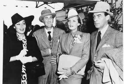 Dolores del Rio, Cedric Gibbons, Marlene Dietrich and Erich Maria Remarque, circa 1955. (Photo courtesy of Getty Images)
