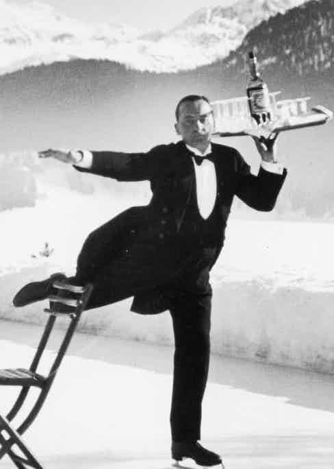 Waiter Rene Brequet w. a tray of cocktails as he skates around rink serving sidelined patrons at the Grand Hotel.(Photo by Alfred Eisenstaedt/Time & Life Pictures/Getty Images)
