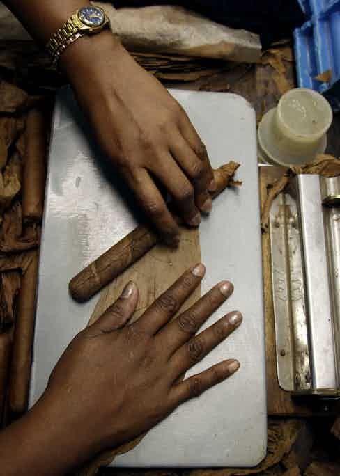 A worker rolls cigars at the Cohiba cigar factory, 2012. (AP Photo/Javier Galeano)