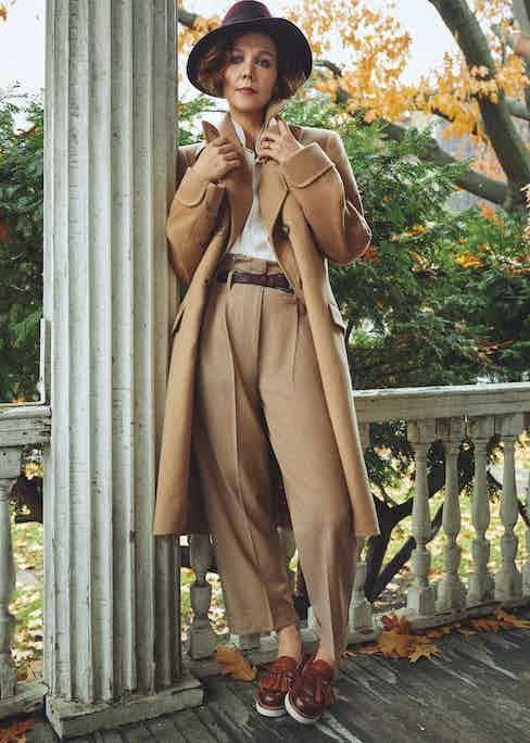 Camel Loro Piana wool Naphill greatcoat, Kit Blake; ivory silk shirt, Emma Willis; camel virgin wool trousers and brown leather belt, both Brunello Cucinelli; tan calf leather tassel loafers; Grenson; burgundy felt fedora, Lock & Co.