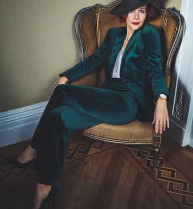 Emerald green velvet suit, The Deck; olive green felt fedora, Lock & Co; grey Olympie bodysuit in stretch jersey and bobbin mesh lace trim, ERES; black leather shoes, Jimmy Choo; Classique wristwatch in rose-gold, Breguet.