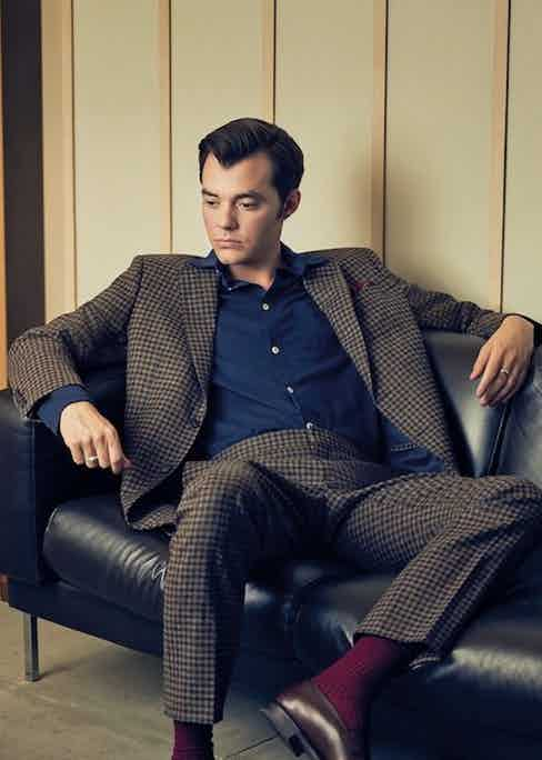 Brown wool gunclub suit, Hacket; blue jersey shirt, Hamilton and Hare; red wool medallion pocket-square, Brunello Cucinelli; burgundy cotton socks, London Sock Company; dark oak antique calf Piccadily loafers, Edward Green. Ring property of Jack Bannon.