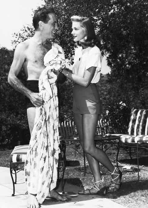 Bogart and Bacall at home by the pool. Image by © Underwood/Corbis