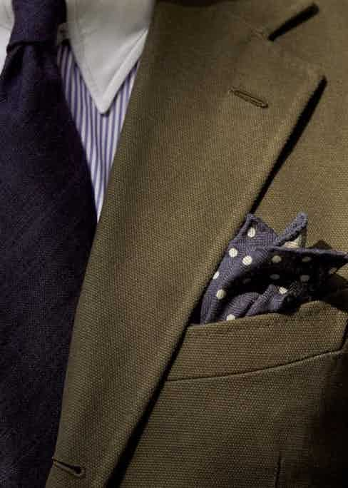 Mathias Le Fevre in Drake's olive plain weave cotton single-breasted suit. (Photo by Nick Tydeman)