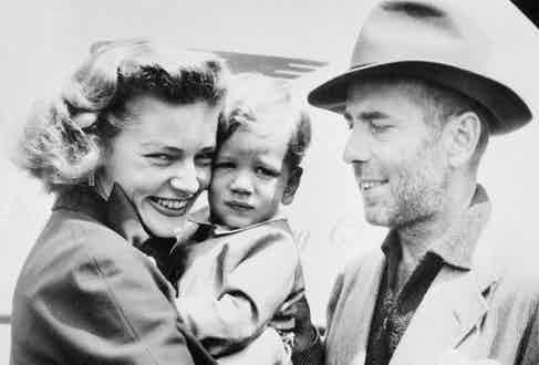 Mother and fatherare reunited with their two-year-old son, Stephen, at an airport in London after finishing the shooting of 1951's The African Queen. Image by © Bettmann/CORBIS