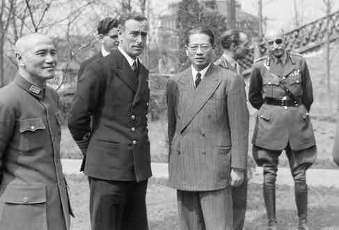 Supreme Allied Commander South East Asia: Mountbatten with General Chiang Kai-Shek and Dr T V Soong. In the background are Captain R V Brockman, Lt Gen F A M Browning and General Carton de Wiart VC at Chungking.