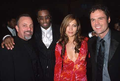 At a Party for the 42nd Grammy Awards with the then Puff Daddy (now Sean Combs), Jennifer Lopez and Donny Osmond.