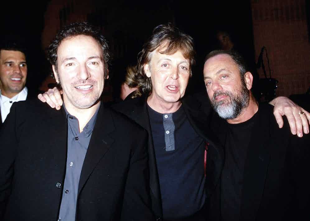 Joel with Bruce Springsteen and Paul McCartney.