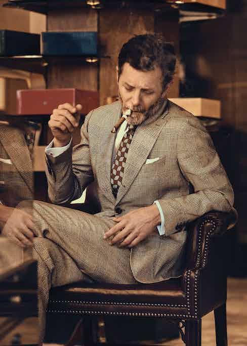 Natural Glen check linen suit, Drake's at The Rake; sky blue cotton shirt, Budd Shirtmakers; chocolate brown silk geometric print tie, Edward Sexton; White cotton handkerchief, stylist's own.