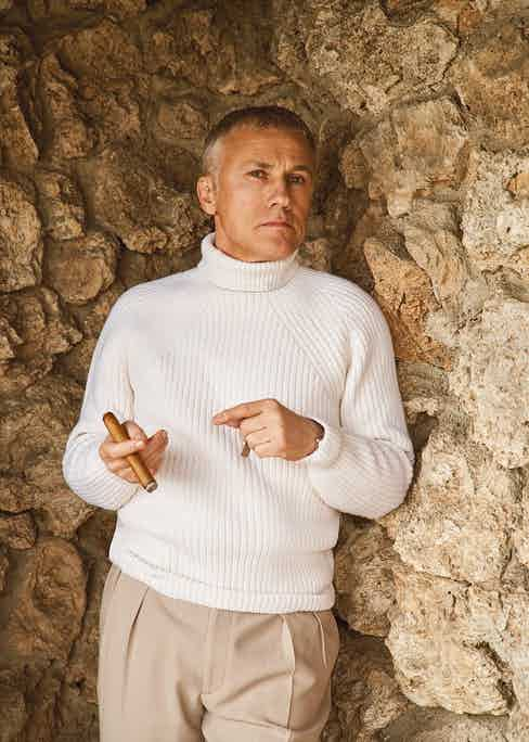 Cream cashmere roll-neck, Anderson & Sheppard; tan crepe trousers, Ralph Lauren Purple Label; brown cotton socks, London Sock Company; brown leather loafers, George Cleverley.
