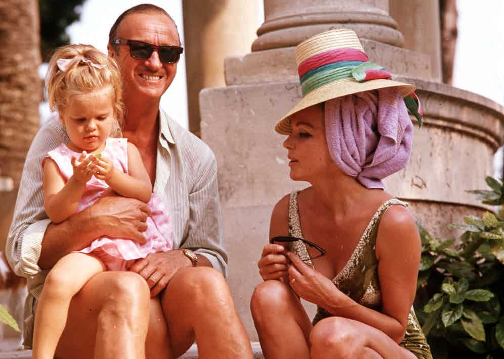 David Niven is pictured with his wife Hjordis Genberg and daughter at their home. (Photo by Popperfoto via Getty Images/Getty Images)