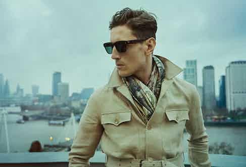 Sand linen belted safari jacket, Ralph Lauren; tortoiseshell acetate Jeremy Hackett signature sunglasses, Hackett; Zodiac scarf Lana wool, Nick Fouquet.