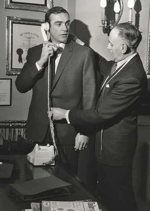 Anthony Sinclair fitting Connery. Photo by Harry Myers/Shutterstock