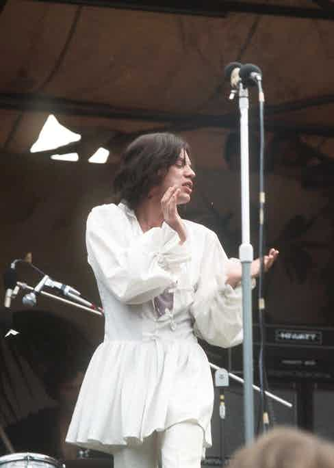 Mick Jagger in Mr Fish man-dress Hyde Park, 1969. Photo by Mike Randolph/Shutterstock.