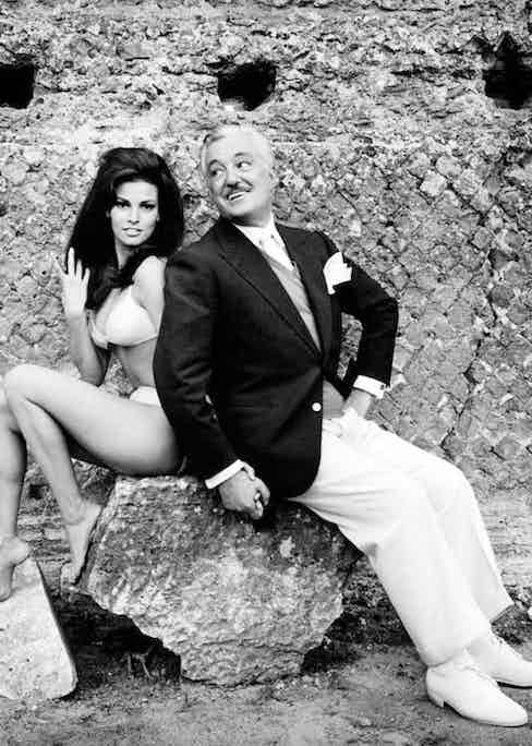 Italian actor Vittorio De Sica holding by the hand American actress Raquel Welch (Jo Raquel Tejada) wearing a bikini. They're acting in the film The Biggest Bundle of Them All. 1968