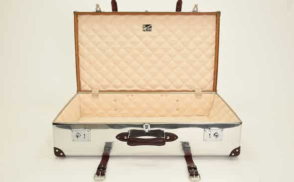 Globe-Trotter donates aluminium travel case to Covid-19 Solidarity Auction