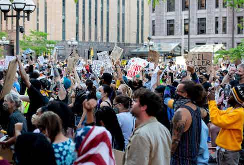 Protestors rally outside the Hennepin County Government Center on Thursday, May 28, 2020, during the third day of protests over the death of George Floyd in Minneapolis. (Photo by Steel Brooks - AnadoluAgency courtesy of Alamy)