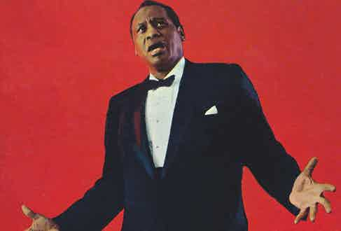 Photo of American actor and singer Paul Robeson (1898-1976) performing circa 1950. (Photo by GAB Archive/Redferns)