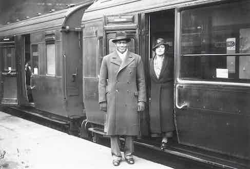 Paul Robeson and his wife, Eslanda leaving Waterloo station, London. (Photo by H F Davis/Getty Images)