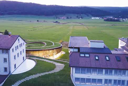 the new building is elegantly placed in Switzerland's Vallée de Joux and adjacent to the 1875-founded workshop