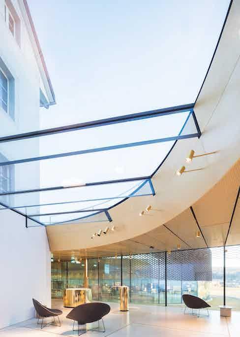 the modern design against the ancient landscape of Switzerland's Vallée de Joux.