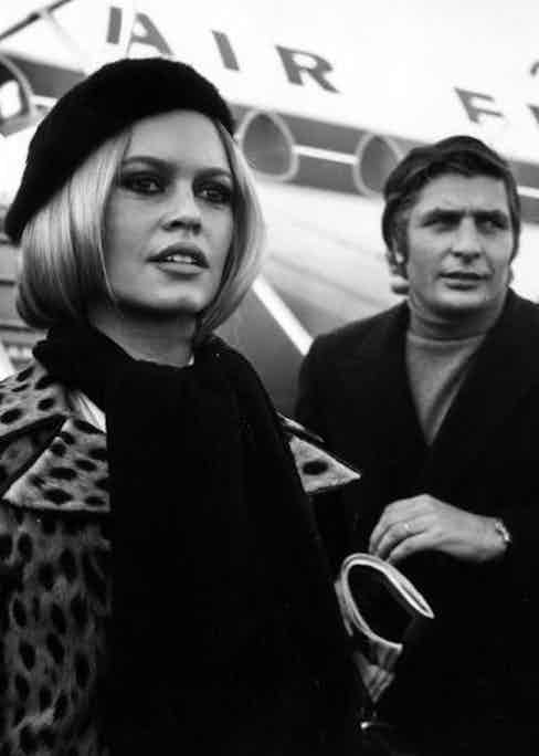 Brigitte Bardot and Gunter Sachs arrive at London airport. (Photo by George Stroud/Express/Getty Images)