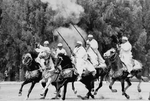 Moroccan horsemen display their decorative riding & shooting at Malcolm Forbes' 70th birthday gala on grounds of his Tangier Country Club.  (Photo by Terry Smith/The LIFE Images Collection/Getty Images)