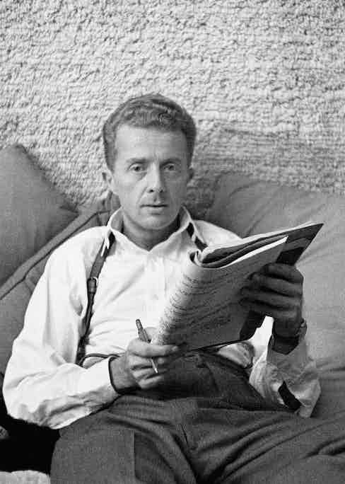 Paul Bowles, seated with manuscript. Image by © Condé Nast Archive/Corbis