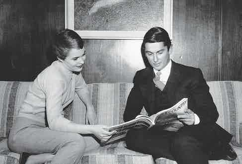 Evans and the American actress Jean Seberg read Town & Country magazine, 1967 (Photo courtesy of Getty)